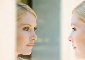 49798181 - woman looking at her reflection